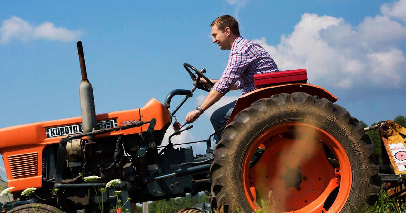 Man-Driving-Tractor.jpeg