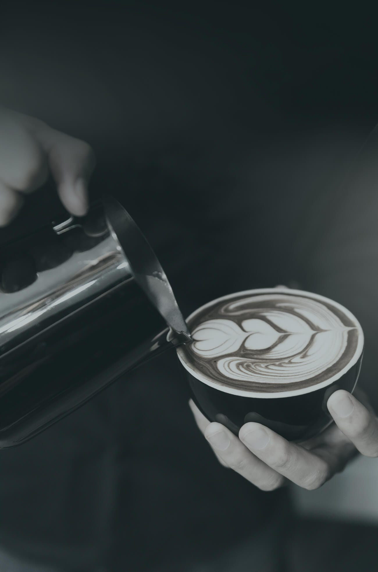 Dartcor Food Services Corporate Dining Team prepares latte with foam design